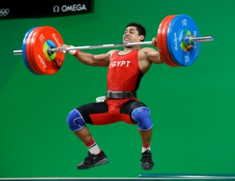 Mohamed Mahmoud, of Egypt, competes during the men's 77kg weightlifting competition at the 2016 Summer Olympics in Rio de Janeiro, Brazil, Wednesday, Aug. 10, 2016. (AP Photo/Mike Groll)