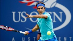 Roger Federer, of Switzerland, returns a shot against Marcel Granollers, of Spain, during the third round of the 2014 U.S. Open tennis tournament, Sunday, Aug. 31, 2014, in New York. (AP Photo/Kathy Willens)